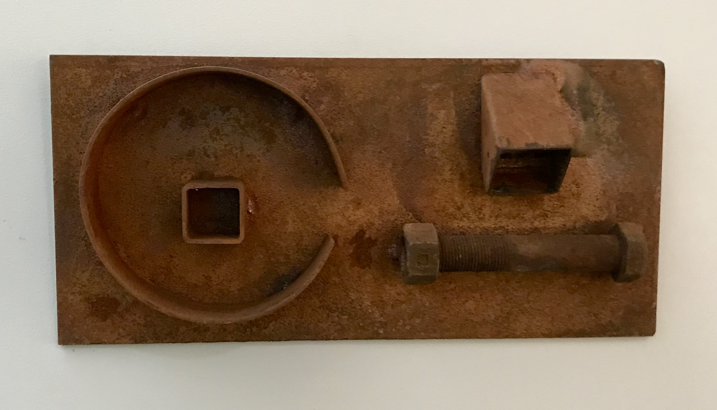 Linguistic 5x11x3 rusted steel, bolt and pipe